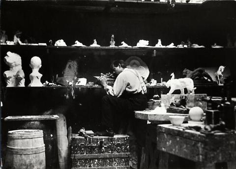 Arthur Putnam Working in His Studio